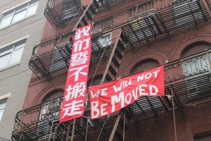 Signs protesting the displacement of families in Chinatown