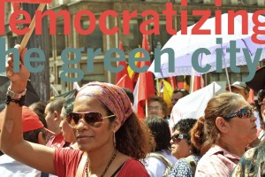 "Text saying ""democratizing the green city"" over an image of a crowd of people stand in the street"
