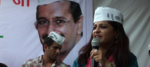 Shazia Ilmi speaks into a microphone