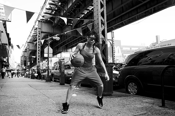 Woman dribbling a basketball on a New York City sidewalk