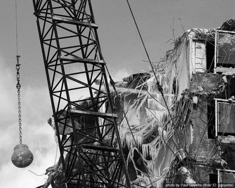 A wrecking ball and a destroyed building
