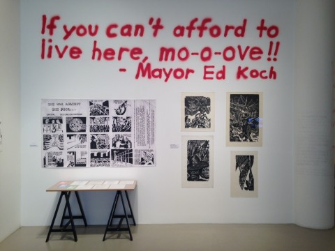"Gallery entrance with the words ""If you can't afford to live here, m-o-ove!! -Mayor Ed Koch"" spray painted on the wall"
