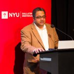 "Balakrishnan Rajagopal presenting a slideshow during ""The Right to the City as a Human Right"" event"