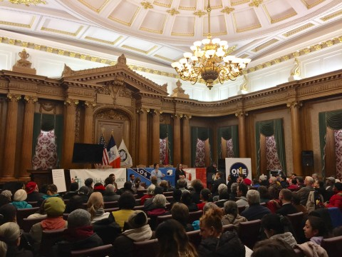 A crowd of people listen to Diana Reyna speaking at Brooklyn borough hall