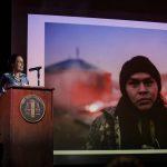 Winona LaDuke speaking at a podium
