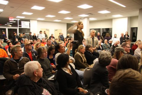 Residents attending a community board meeting